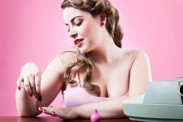 sexy secretary painting her nails at work - funny fat lady stock photos and pictures