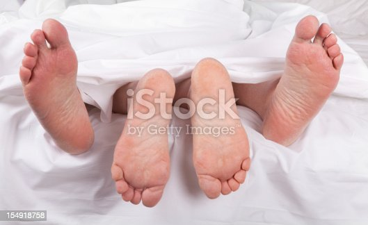 istock sexy senior feet in bed 154918758