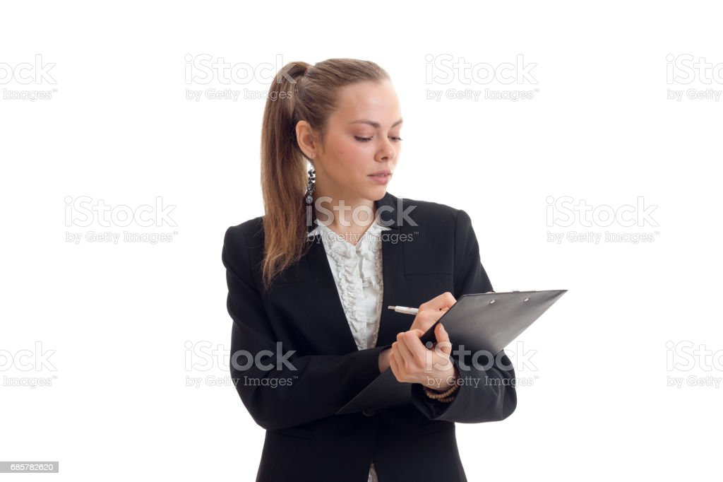 sexy serious blonde in an Office suit makes entries in the Tablet close-up royalty-free stock photo