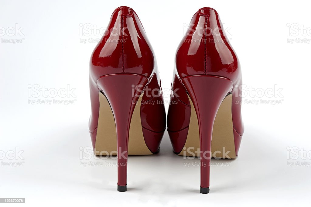 Sexy shiny red patent leather high heels stilettos shoes stock photo