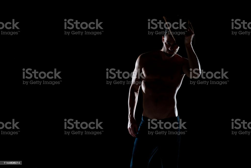 Sexy shirtless cowboy with back lighting