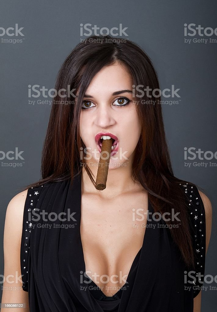sexy smokers in gray background royalty-free stock photo