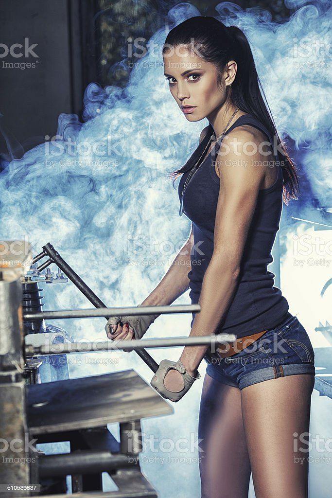 sexy soldier woman on factory ruins stock photo