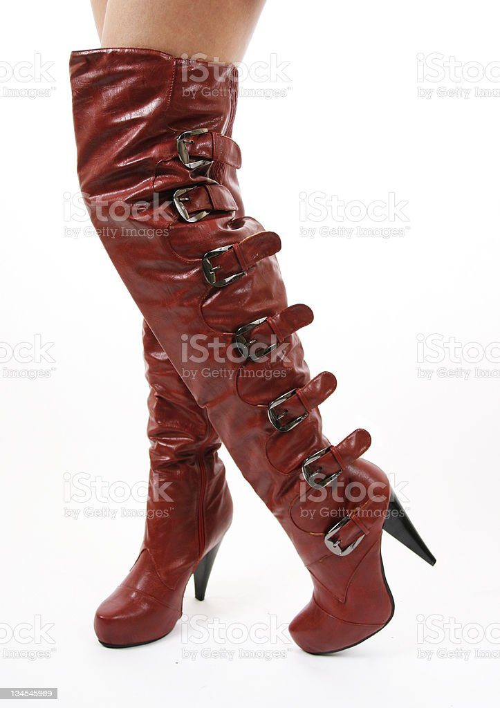 Sexy thigh-high buckle red leather boots stock photo