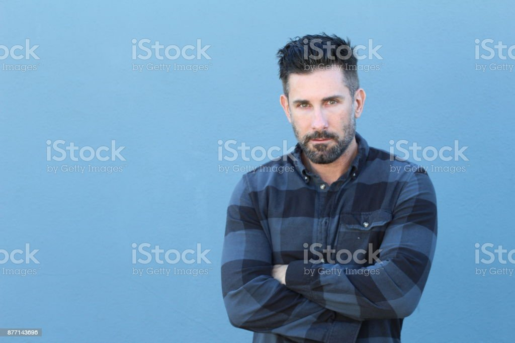 Sexy trendy man with beard crossing his arms stock photo