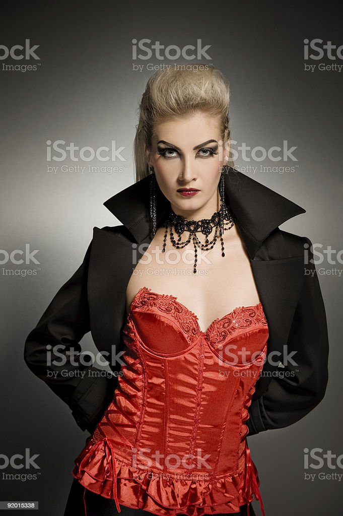 Sexy vamp woman with creative hairstyle royalty-free stock photo