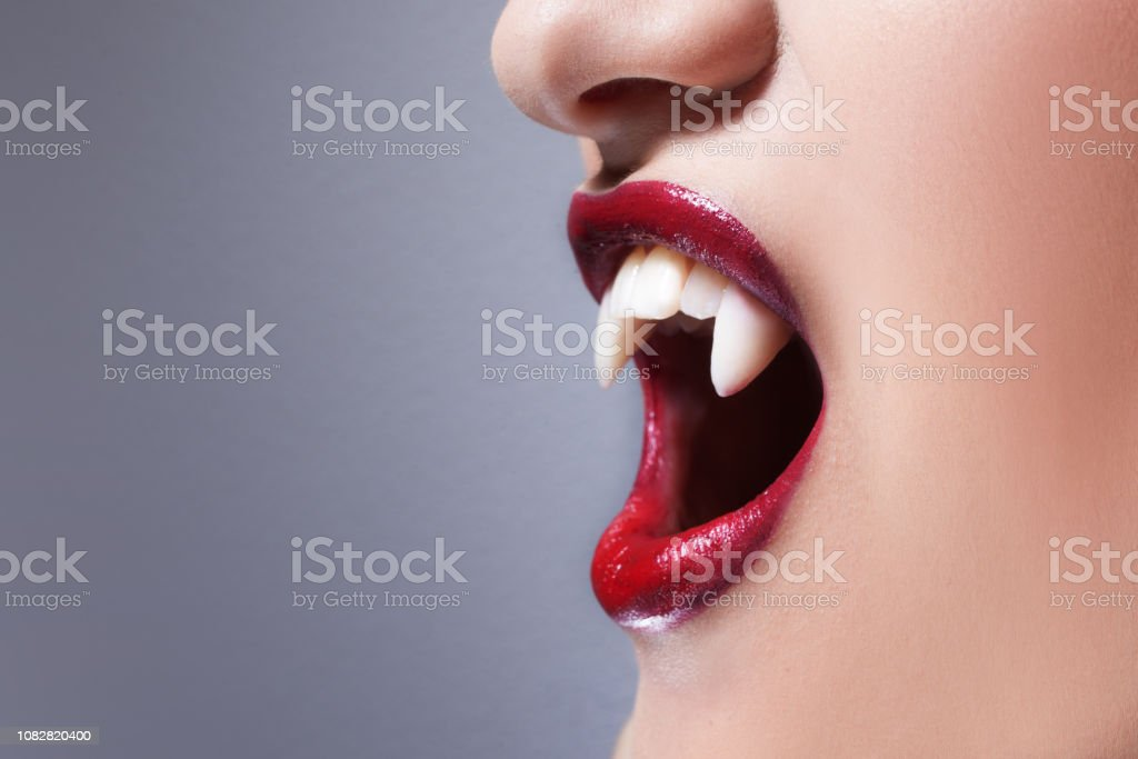 Sexy Vampire Womens Lips With Red Lipstick Screaming Mouth With Vampire Fangs Stock Photo Download Image Now