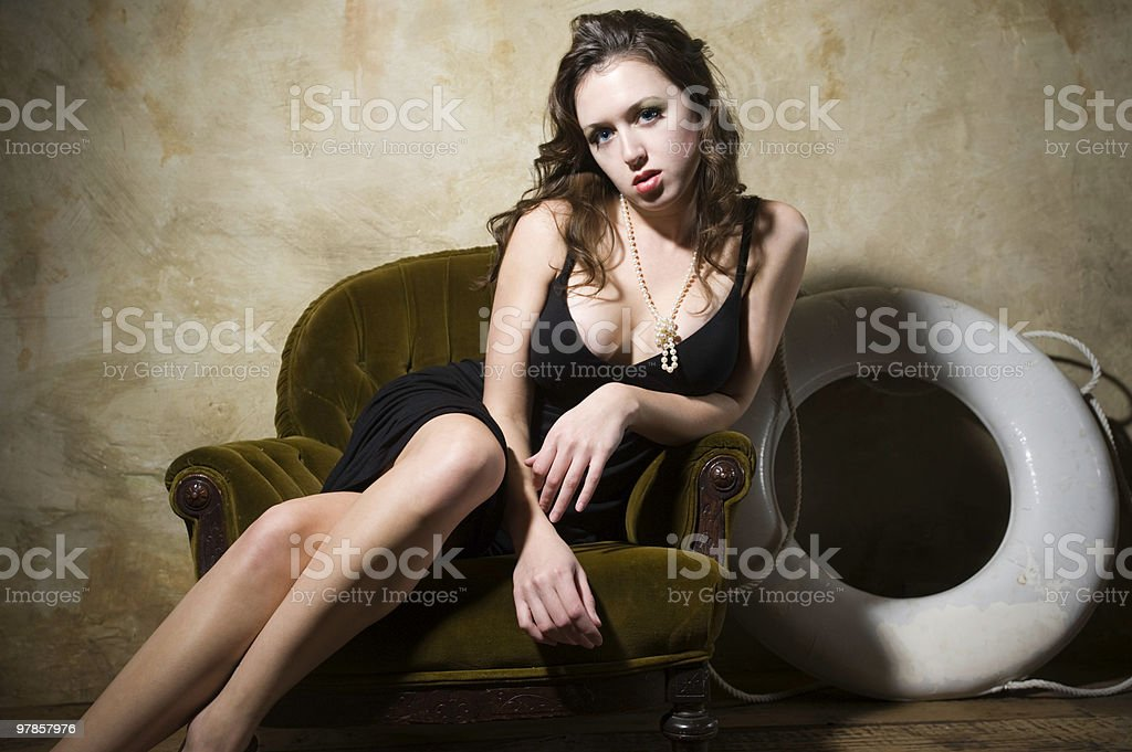 Sexy well-dressed Housewife with a disappointed look on her face stock photo
