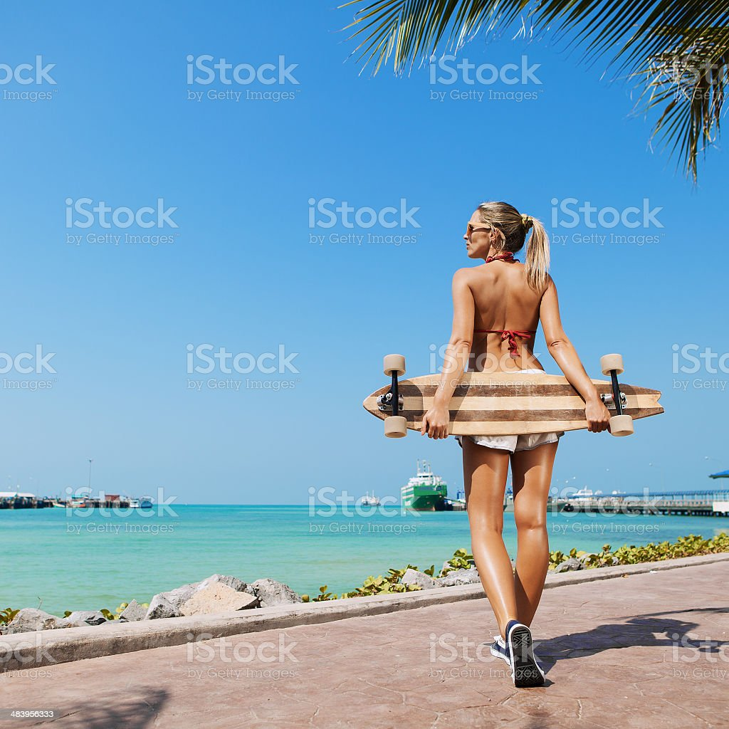 sexy woman and  longboard stock photo
