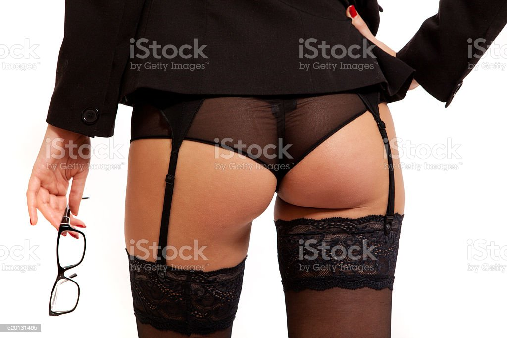 Sexy woman ass with black lingerie, suspenders and glasses stock photo