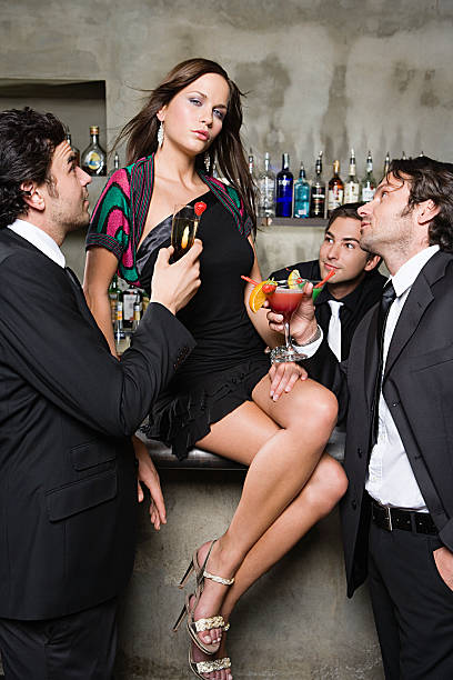 Sexy woman being adored by men stock photo
