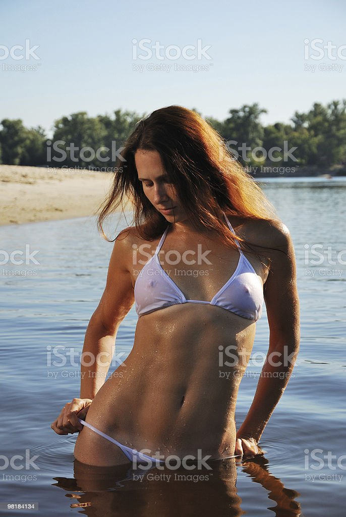 Sexy woman dipping into the river royalty-free stock photo