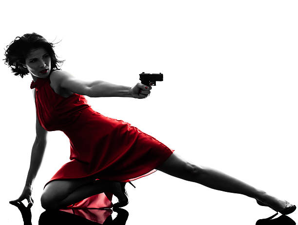 sexy woman holding gun silhouette - female spy stock photos and pictures