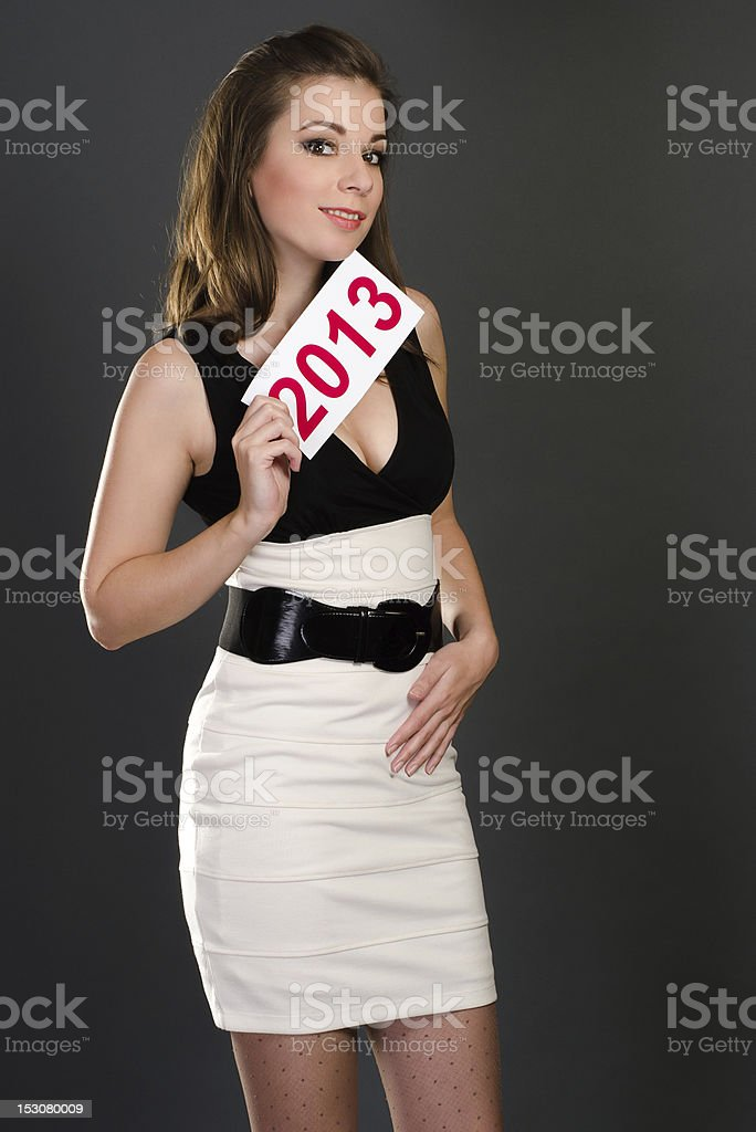 sexy woman holding label 2013 royalty-free stock photo