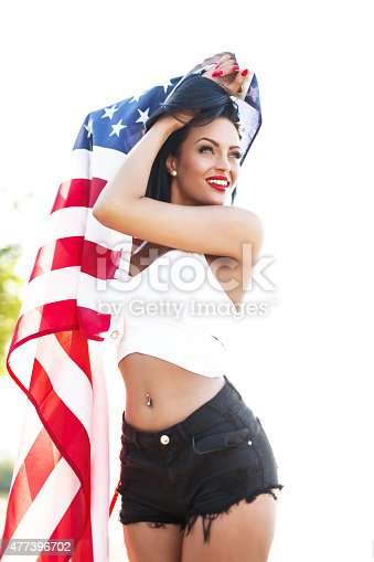istock Sexy woman holding usa flag outdoor 477396702