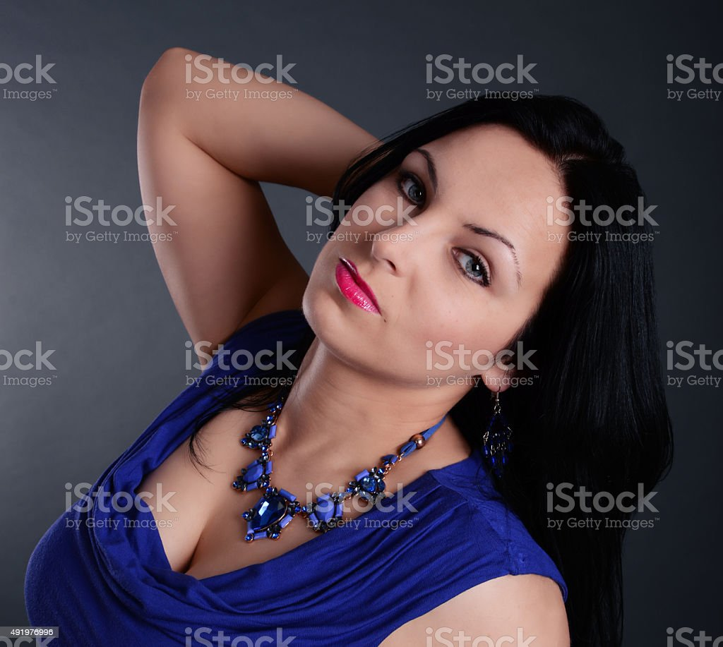 sexy woman in a blue dress stock photo
