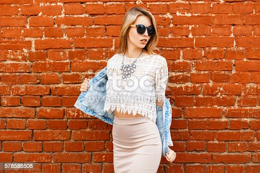 578791454istockphoto Sexy woman in a vintage white lace blouse and jacket 578588508