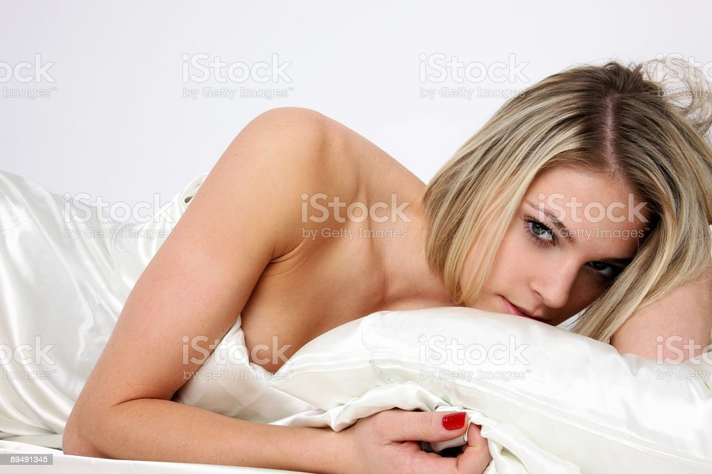 Sexy woman in bed royalty-free stock photo