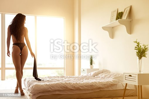 Sexy woman in bedroom