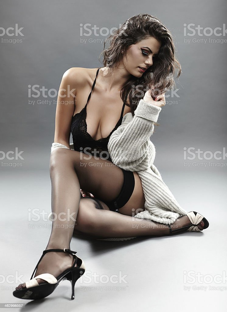 Sexy woman in black lingerie and cardigan stock photo