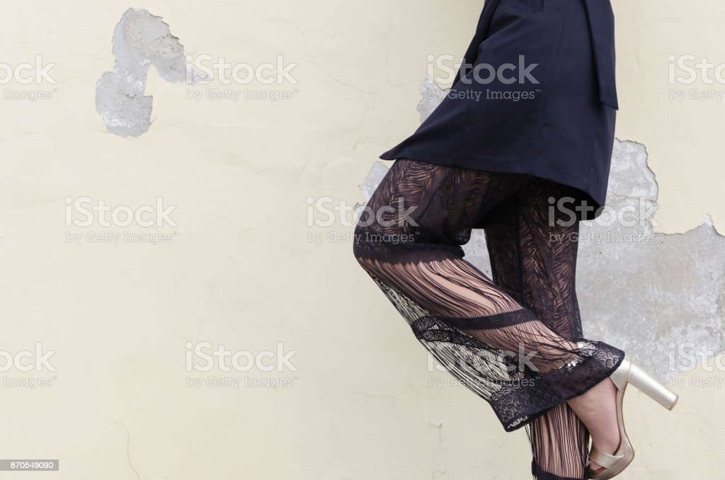 Sexy woman in black transparent pants stock photo