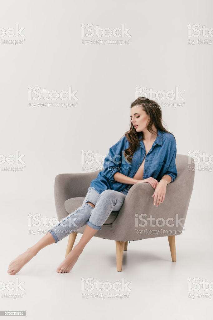sexy woman in denim clothes stock photo