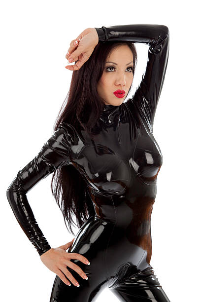 sexy woman in latex cat suit stock photo