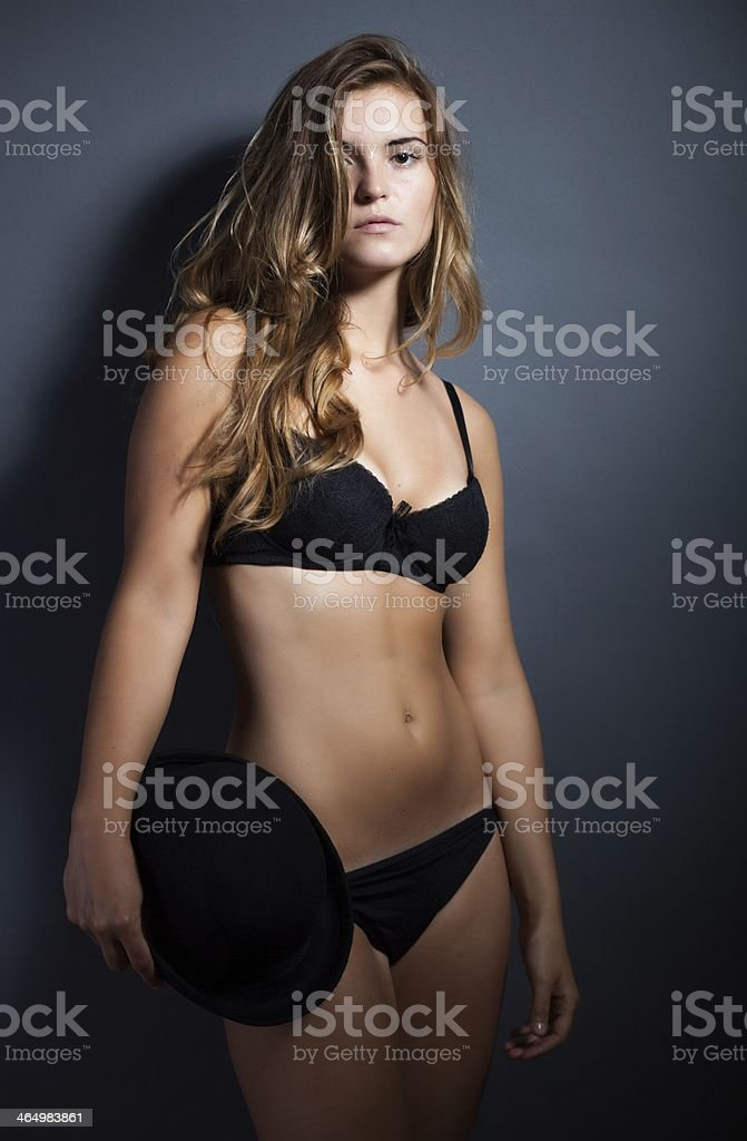223345c75cd Sexy Woman In Lingerie And Hat Dark Background Stock Photo   More ...