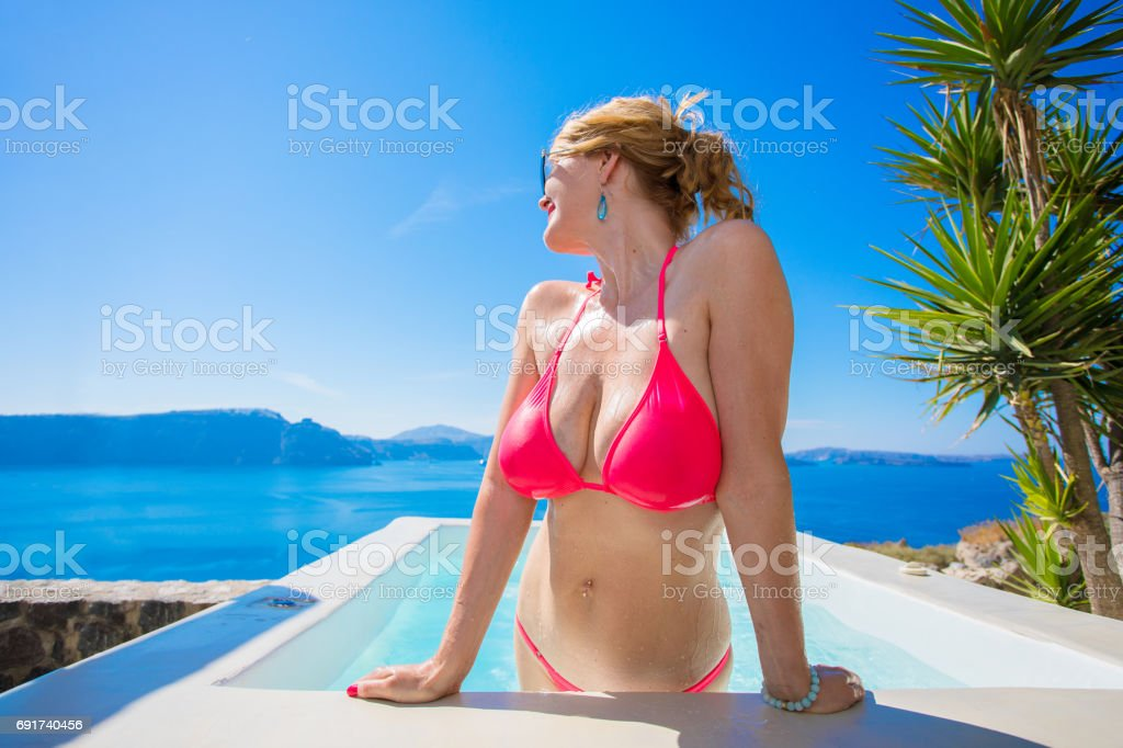 Sexy woman in pink bikini stock photo