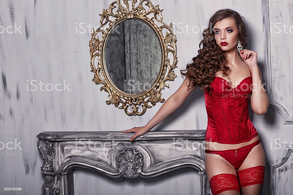 Sexy woman in red lingerie stock photo