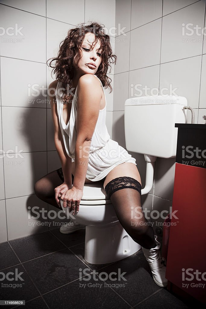 Sexy girl on the toilet