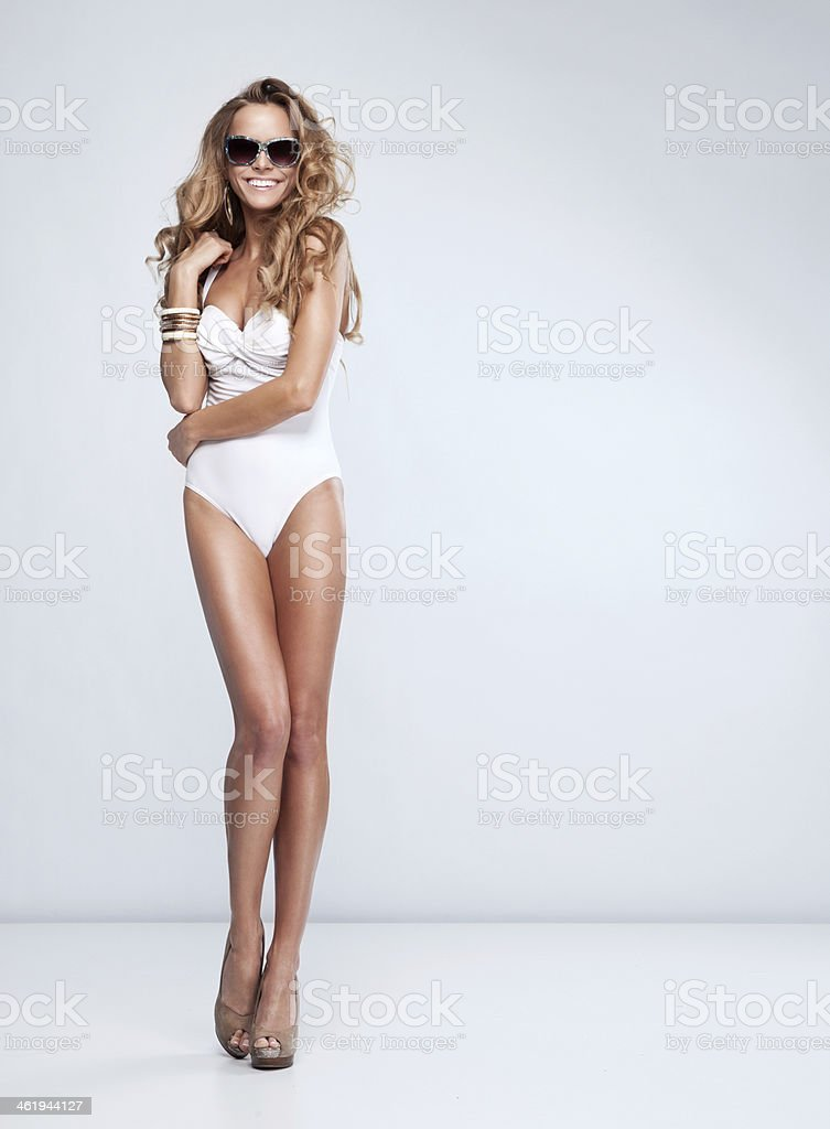 Sexy woman in swimsuit with sunglasses stock photo
