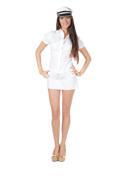 Sexy woman in white navy outfit stock photo