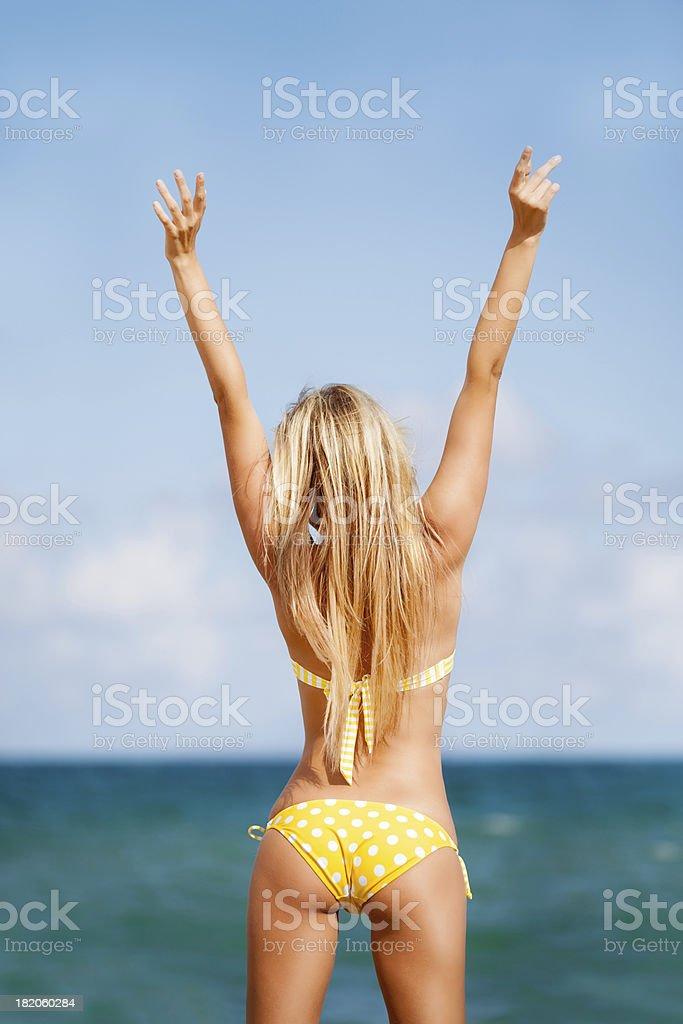 sexy woman in yellow polka dot bikini on beach royalty-free stock photo