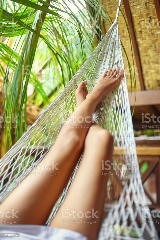 Sexy woman legs in hammock.Vacation concept stock photo