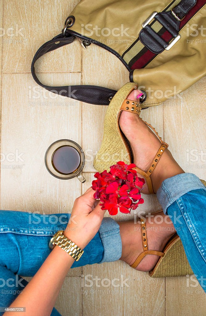 Sexy woman legs on the floor. Top view stock photo