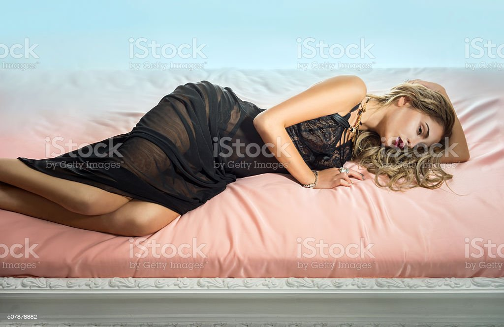 Sexy woman lying in the bed stock photo