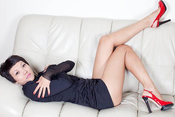 Sexy woman: mini dress/not lie so that stock photo