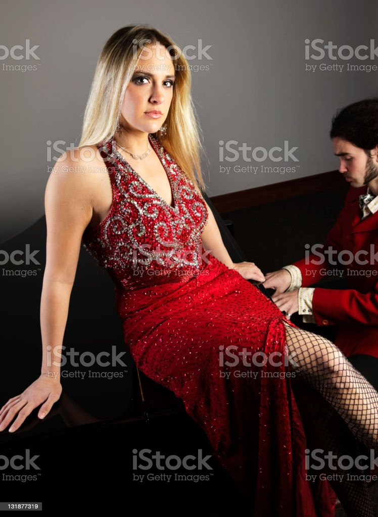 Sexy Woman on a Piano royalty-free stock photo
