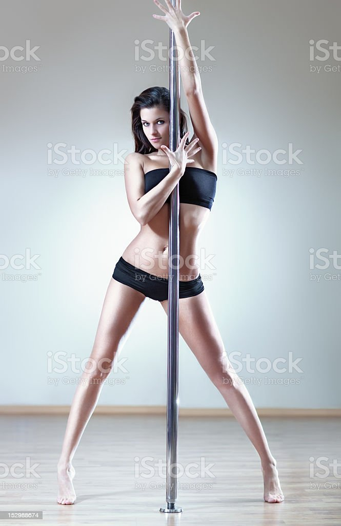 A sexy woman on a stripper pole royalty-free stock photo