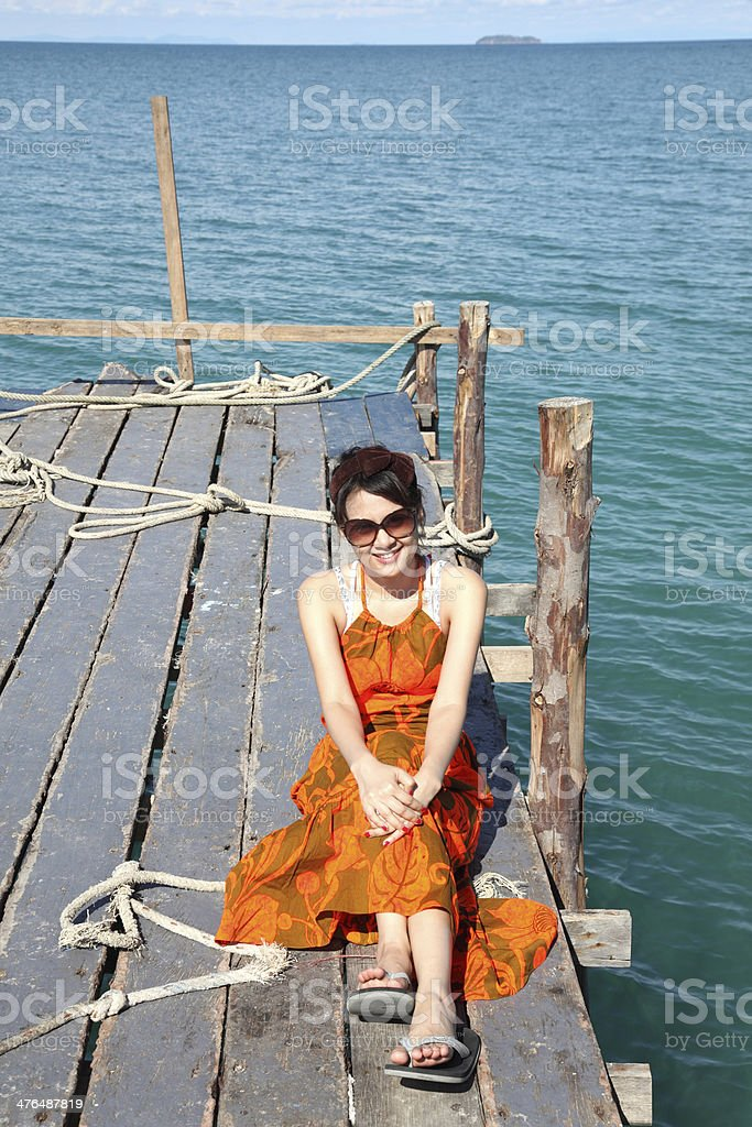 Sexy Woman on the bridge above sea royalty-free stock photo