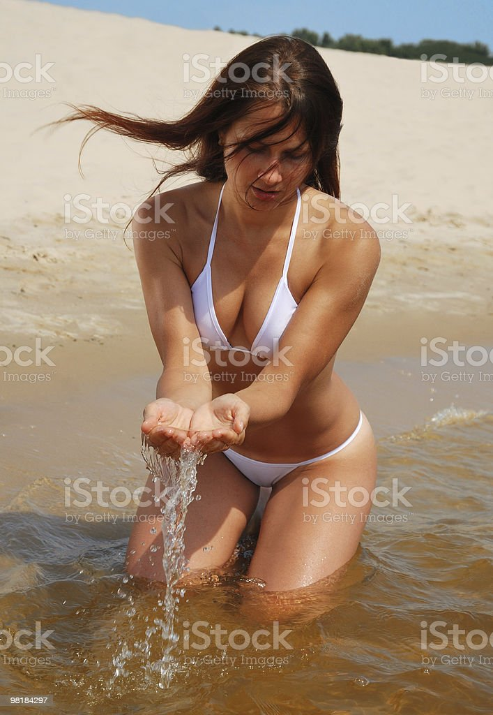 Sexy woman playing with water in the beach royalty-free stock photo