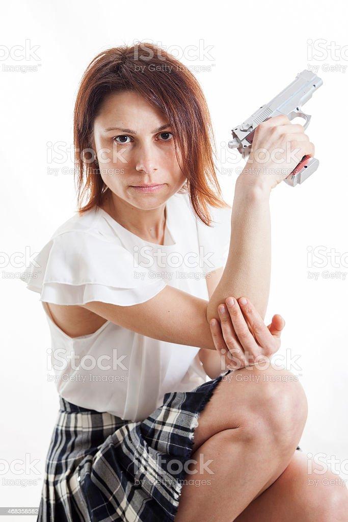 sexy woman posing with gun on white background royalty-free stock photo