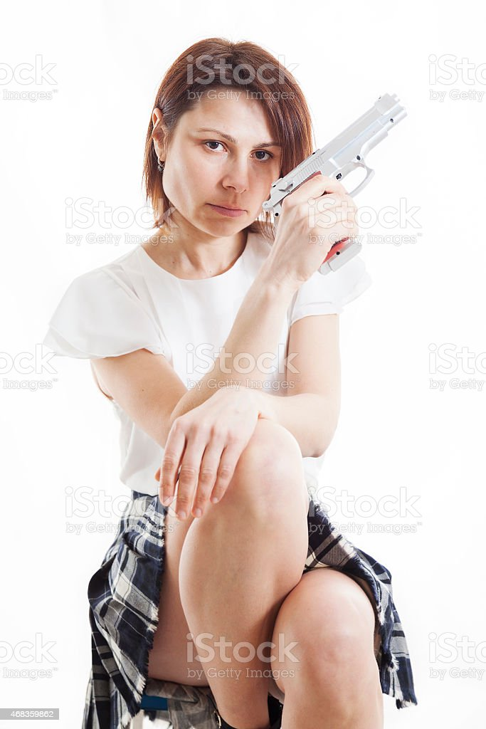 sexy woman posing with gun on white background royalty-free stock photo