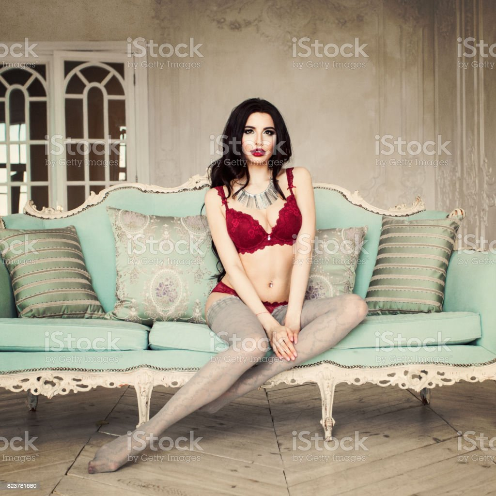 Sexy Woman Relaxing on Vintage Fashion Background stock photo