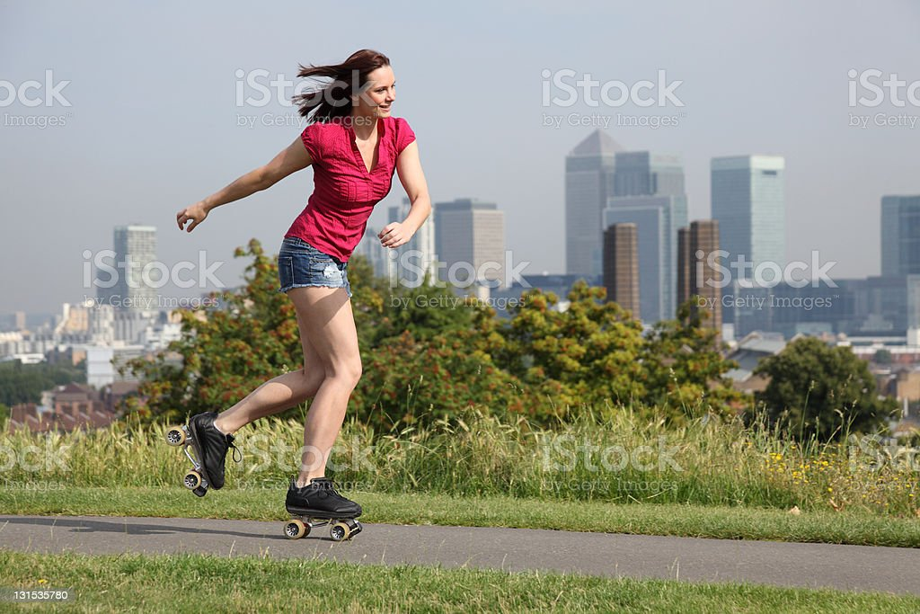 Sexy woman roller skating activity in London UK stock photo