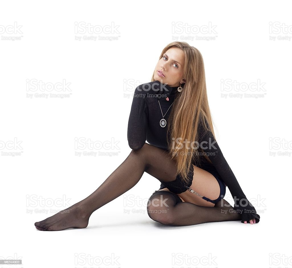 sexy woman sitting on a white background royalty-free stock photo