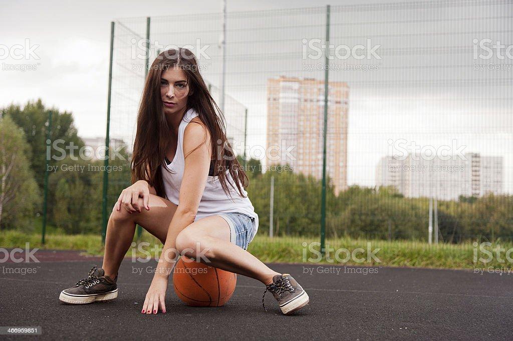 Sexy Woman Sitting On Basketball Sexy Woman Sitting On Basketball On Sports Playground Activity Stock Photo