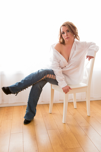 Sexy Woman Sitting On Chair Stock Photo - Download Image