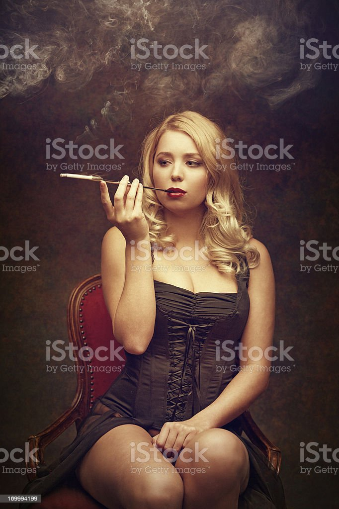sexy woman smoking cigarette royalty-free stock photo